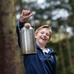 Cairnies boy with tilly kettle at outdoor classroom